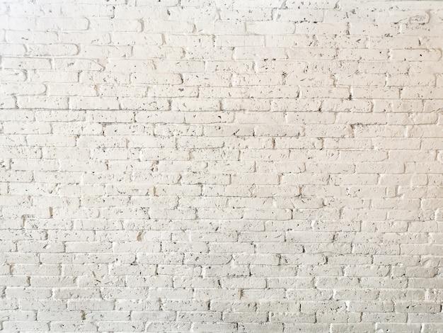 古い白いレンガの汚れた壁の背景テクスチャ。抽象