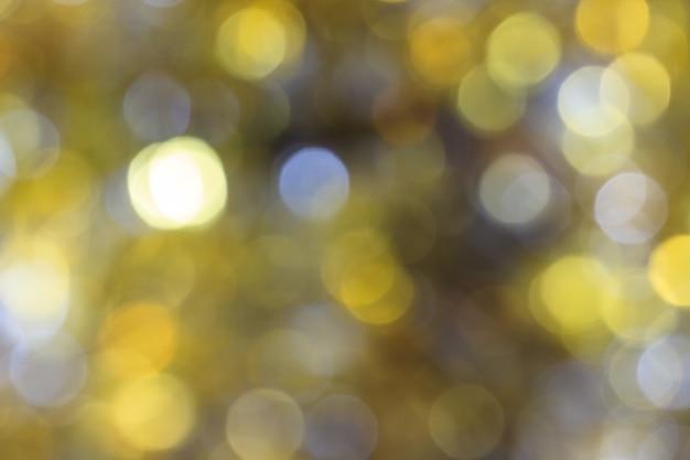 ボケがぼやけた抽象的なツインクライトの明るい背景