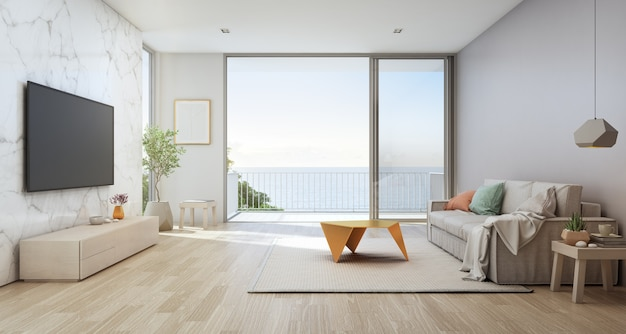ガラスのドアと木製のテラス付きの豪華なビーチハウスの海の眺めのリビングルーム。