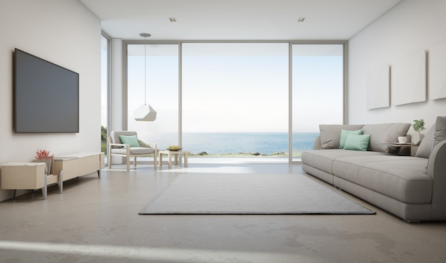 Гостиная с видом на море, роскошный летний домик на пляже с большой стеклянной дверью и деревянной террасой.
