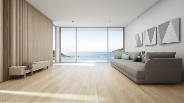 スイミングプールと木製テラス付きの豪華な夏のビーチハウスの海ビューリビングルーム。