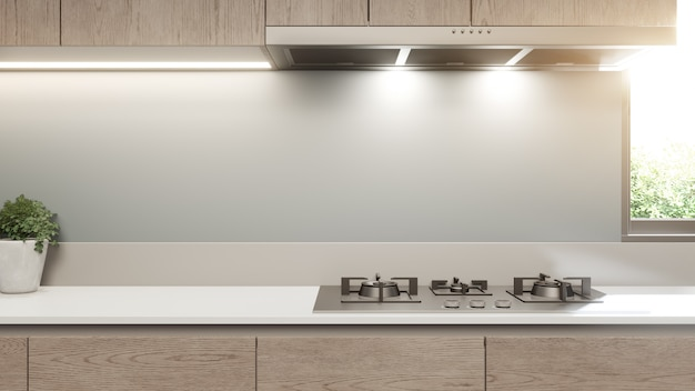 Белый чистый счетчик и деревянный шкаф современной кухни в роскошном доме.