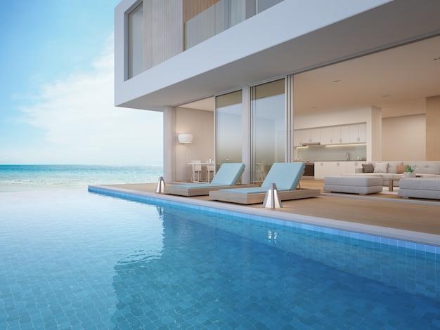 海の眺めのプール付きの豪華なビーチハウス