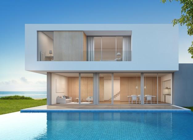 Роскошный пляжный дом с бассейном с видом на море в современном дизайне.