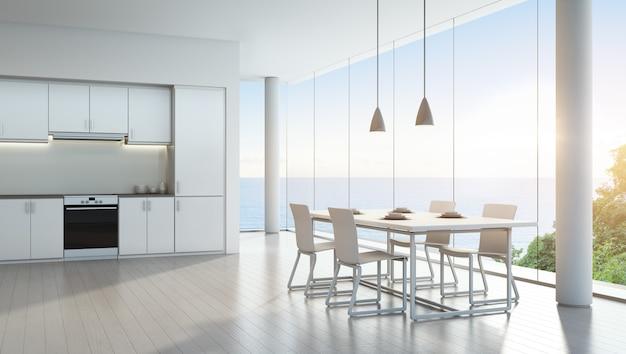 Кухня и столовая с видом на море в роскошном доме для отдыха с современным белым дизайном интерьера.
