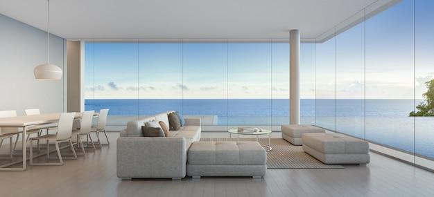 モダンなデザインの海の見えるスイミングプールと豪華なビーチハウスのダイニングとリビングルーム。