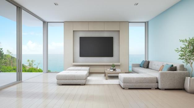 ガラスのドアと木製のテラス付きの豪華なビーチハウスの海の景色のリビングルーム