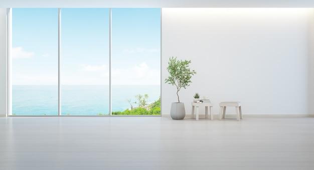 木製の床と空の白い壁と最小限の家具の屋内植物