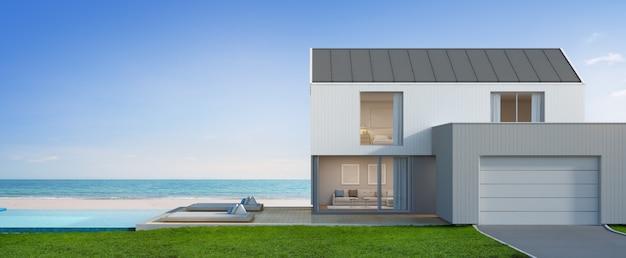 海の見えるスイミングプールとモダンなデザインのガレージ付きの豪華なビーチハウス。