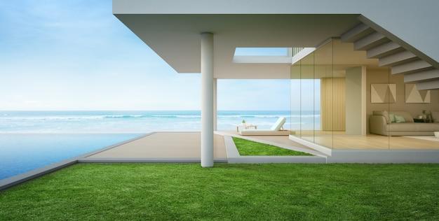 モダンなデザインの海の見えるスイミングプールとテラス付きの高級ビーチハウス。