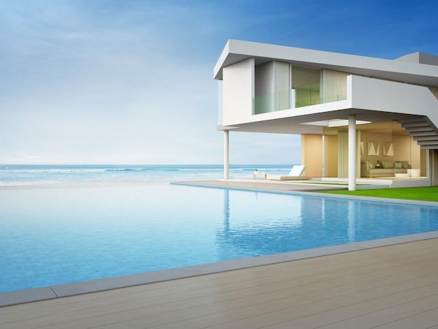 Роскошный пляжный дом с бассейном с видом на море и террасой в современном дизайне.