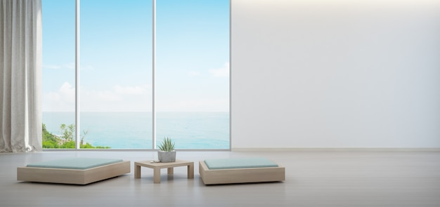 木製コーヒーテーブルと最小限の家具の屋内植物