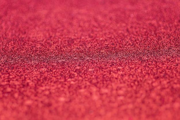 赤いキラキラ紙にセレクティブフォーカス