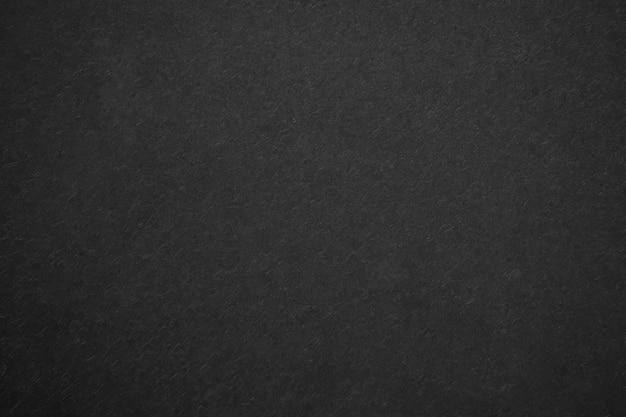 黒キャンバスのテクスチャの抽象的な背景。