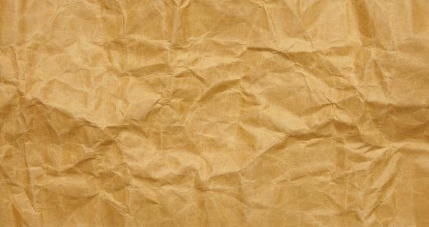 しわくちゃの茶色の紙シートの背景テクスチャ