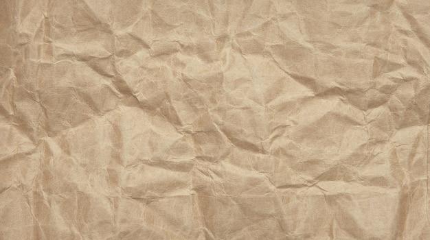 しわくちゃのしわくちゃのクラフト用紙の背景テクスチャ