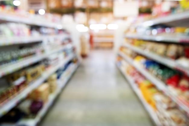 抽象的なぼかしスーパーマーケットや小売店の背景のショッピングモールのインテリア
