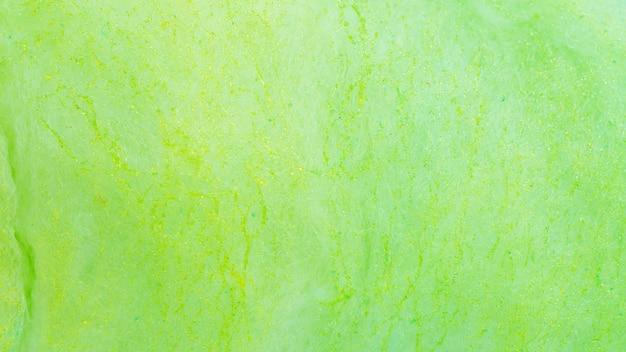 背景の緑の綿菓子のクローズアップ。