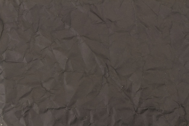 黒のしわくちゃの紙のテクスチャ背景