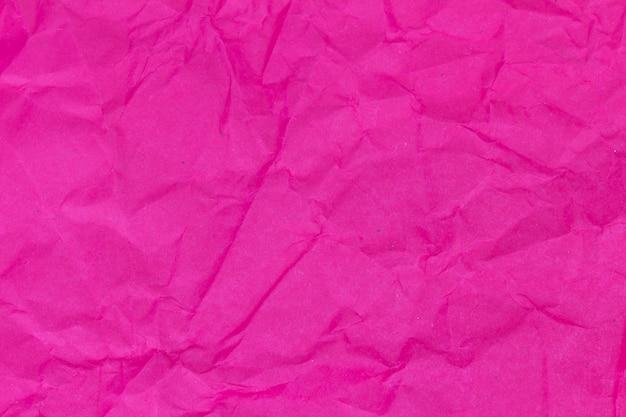 赤。ピンク。しわくちゃの紙のテクスチャ背景
