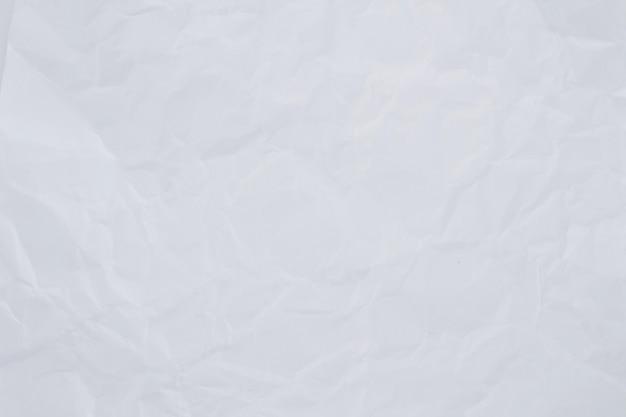 Текстура мятой белой бумаги для фона