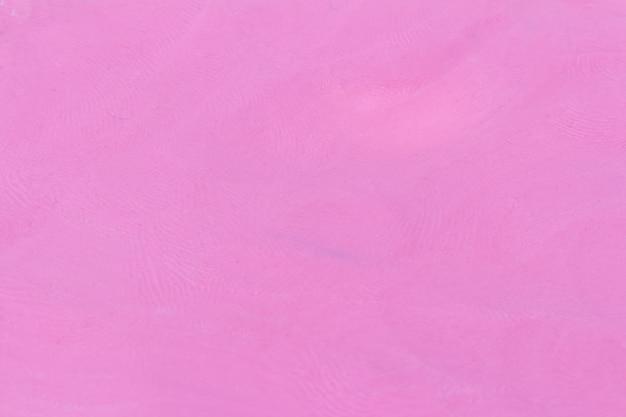 塑像用粘土の濃いピンクのテクスチャ背景