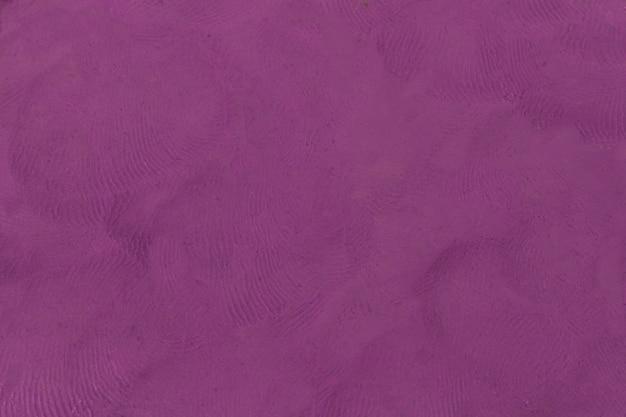 塑像用粘土の紫色のテクスチャ背景