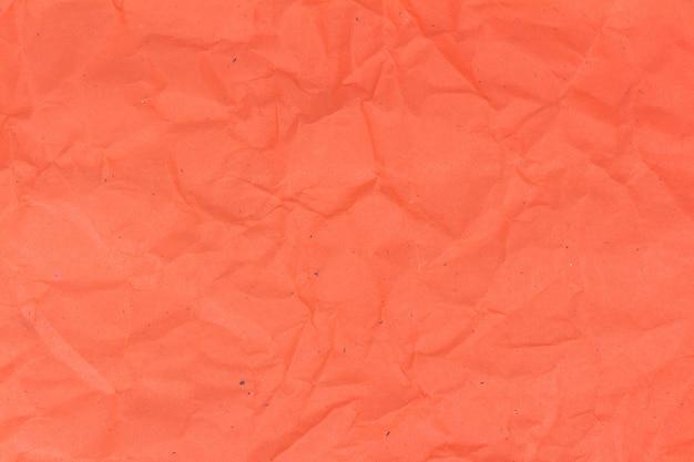 オレンジ色のしわくちゃの紙のテクスチャ背景