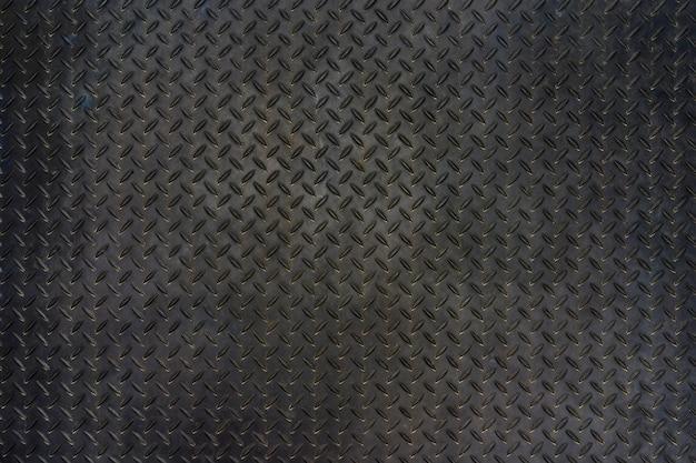 グランジ金属ダイヤモンドプレートの床のテクスチャの背景。