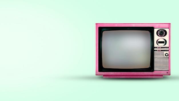 緑色の背景で古いビンテージテレビ