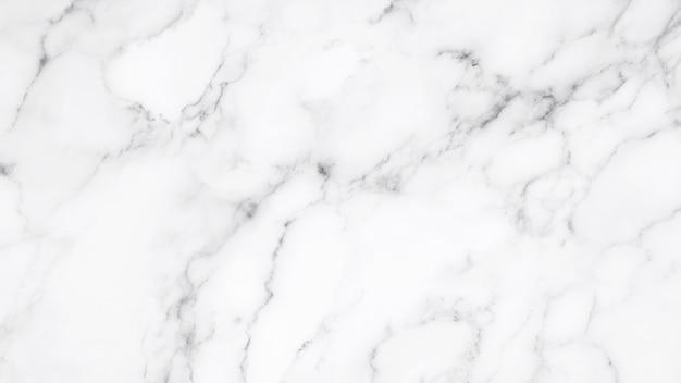 Белая мраморная текстура и предпосылка.