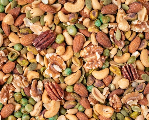 Смешайте орехи, ассорти и различные орехи, фон и текстуры. вид сверху.