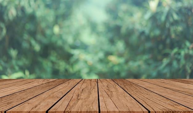 緑色の有機農場の自然の背景古式の木製のテーブルトップ
