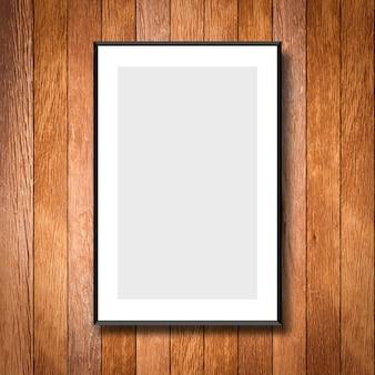 クリームの木の壁の背景に白いポスターフレームをモックアップ
