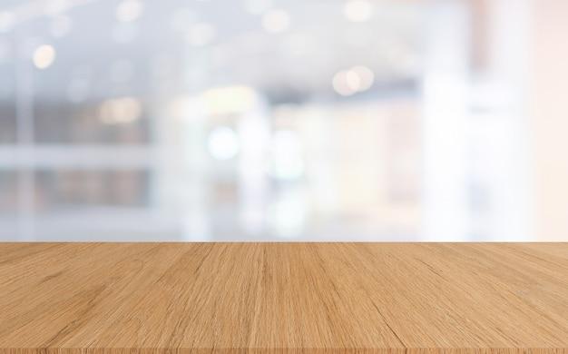 ショーの木のテーブルと抽象的なぼやけ高級ホテルロビー背景表示