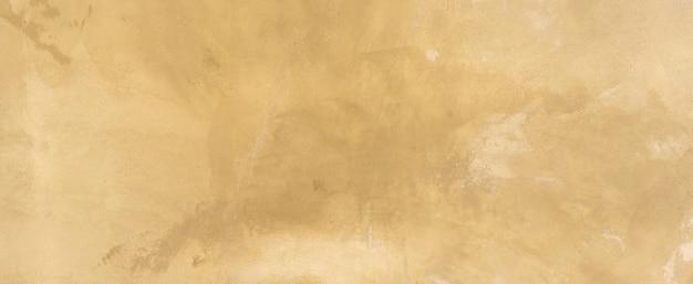 レトロなプレーンタンとセピア色のセメントの壁の背景テクスチャを閉じる