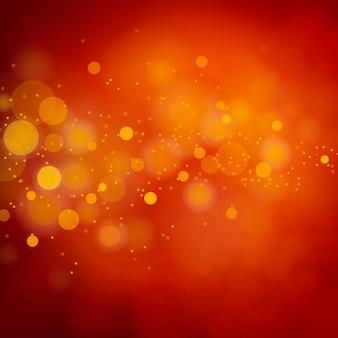 クリスマス赤キラキラ光ボケ抽象的な背景。