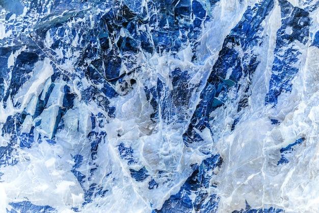 Текстура и предпосылка камня или утеса и льда.