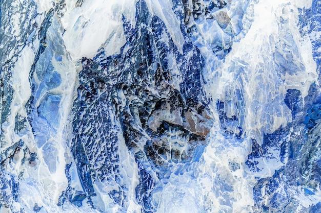 石または岩と氷のテクスチャと背景。