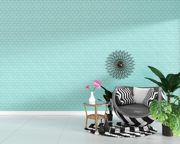 六角形のミントのタイルテクスチャ壁に肘掛け椅子と緑の植物