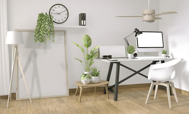 オフィスの禅スタイルとトップテーブルオフィスの装飾のポスターコンピューターのモックアップします。
