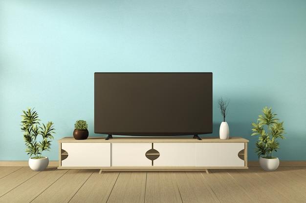 Телевизор на шкафу с растениями