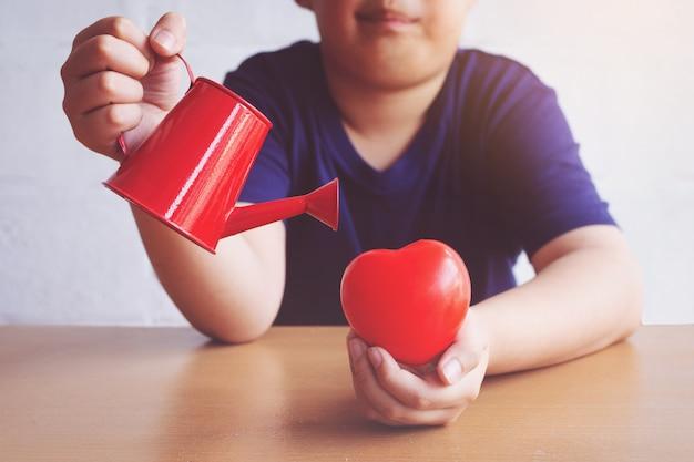赤の心に水をまく少年。バレンタイン