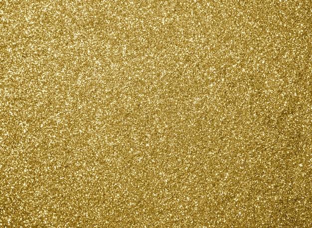 黄金の輝きテクスチャクリスマスの抽象的な背景。