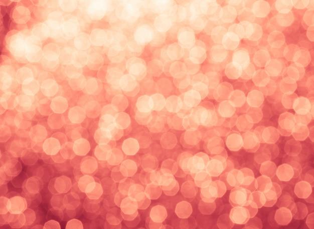 赤とオレンジ色の休日のボケ味。抽象的なクリスマス背景
