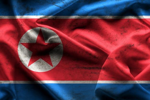 北朝鮮のテクスチャと背景の旗を振っています。