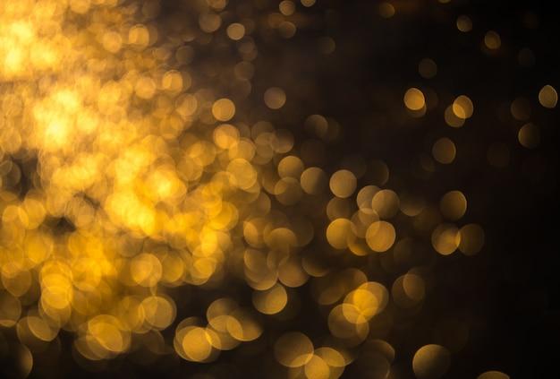 ボケ味を持つクリスマスの背景デフォーカスライト