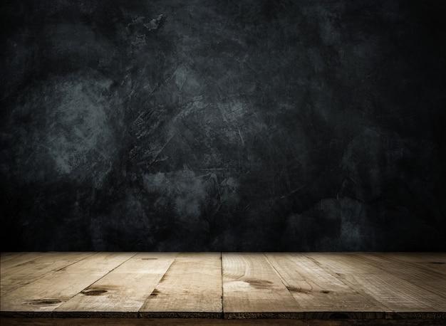 グランジの壁の上の空の木製テーブル製品の表示またはモンタージュの空の準備ができて。