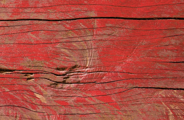 ヴィンテージの木製テーブルバックグラウンドテクスチャの赤い色剥離ペイント。