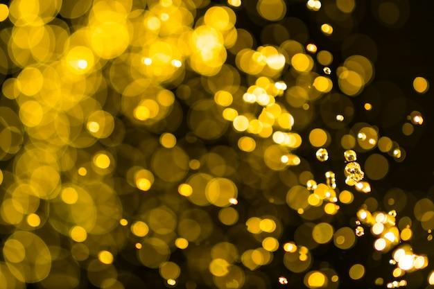 抽象的なゴールデンライト背景のボケ味